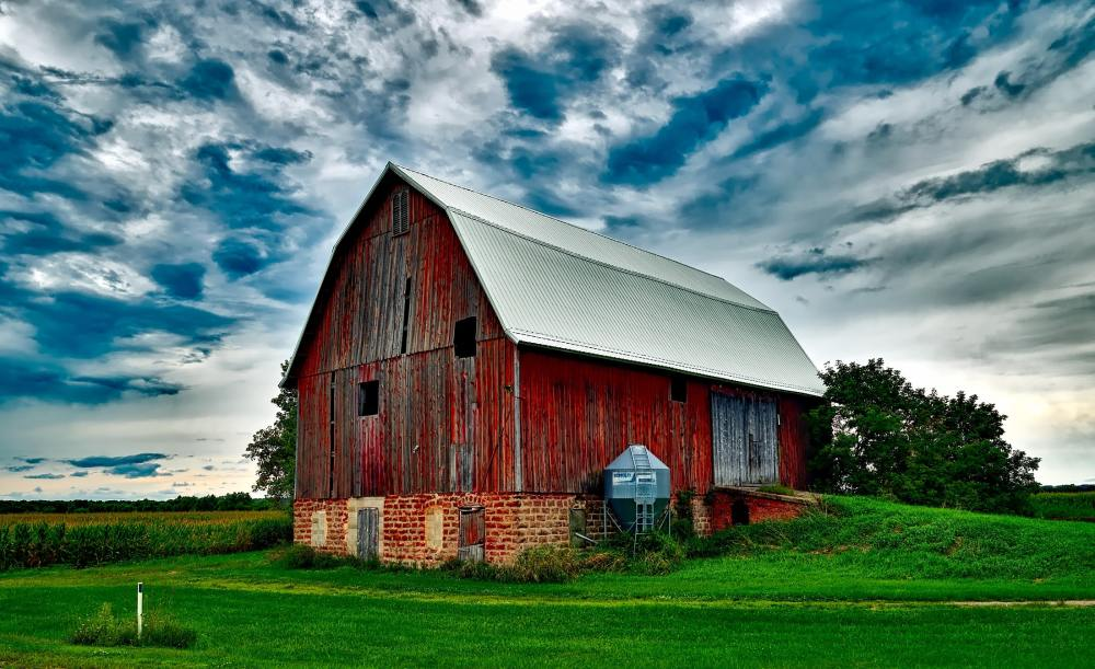 red barn with clouds