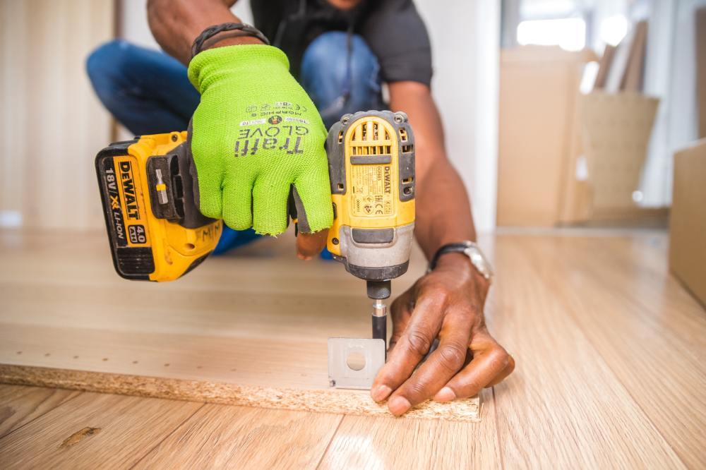 construction worker using electric tools